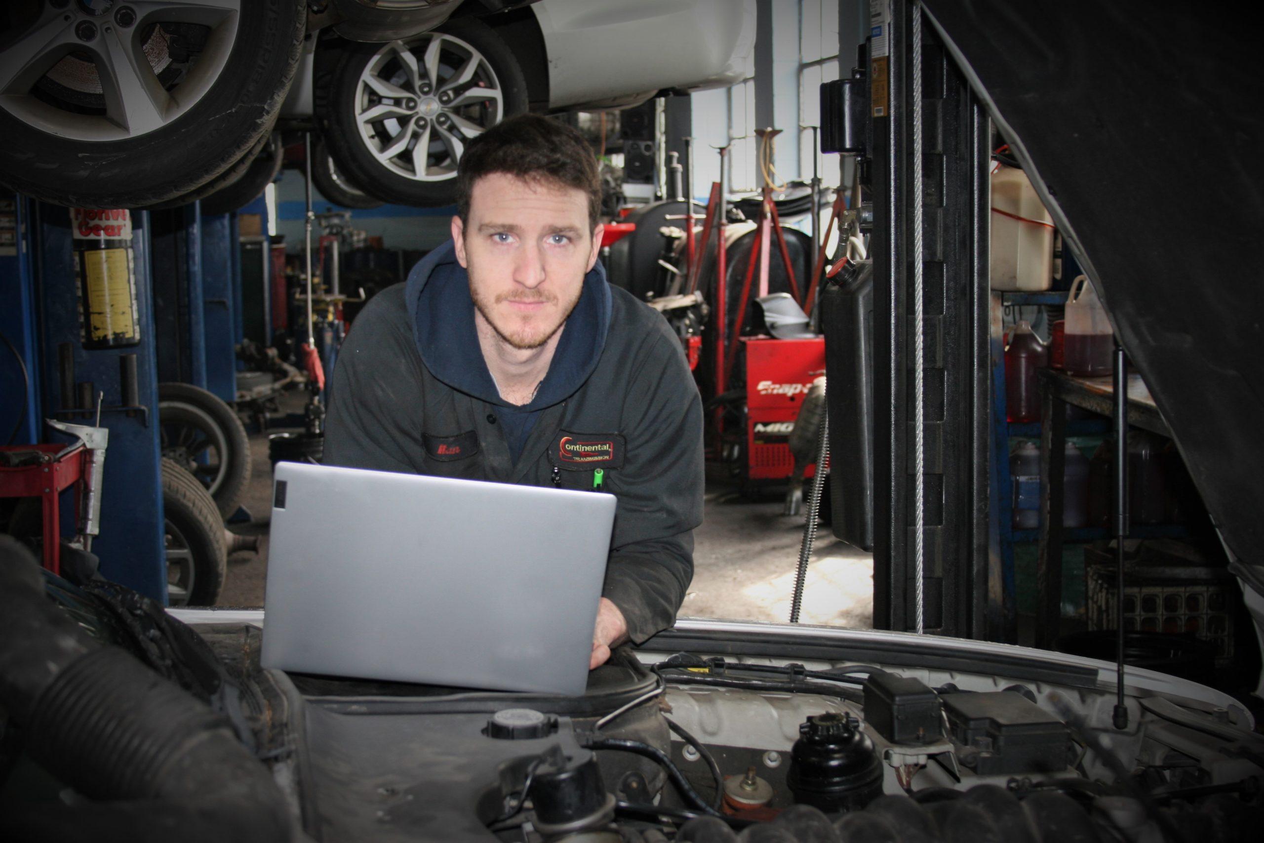 Mechanic doing engine diagnostic test
